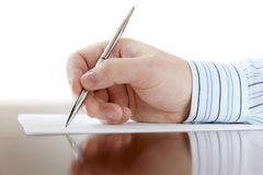 Male hand with pen Royalty Free Stock Images