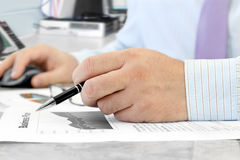 Male Hand with Pen Stock Photography