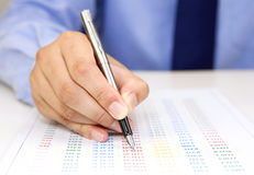 Male hand with pen checking bill Royalty Free Stock Photography