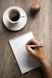 Male hand with pen on empty paper Royalty Free Stock Photos