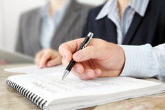 Male Hand with Pen at the Meeting Royalty Free Stock Photography