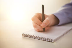 The male hand with a pen Stock Images