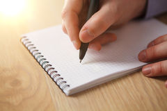 The male hand with a pen Royalty Free Stock Photo