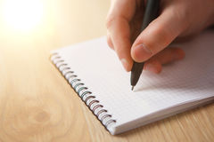 The male hand with a pen Stock Photography
