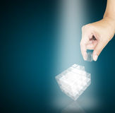 Male Hand pick a piece of glass cube Stock Image