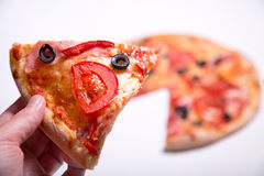 Male hand picking delicious pizza slice stock photography