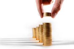 Male hand picking Euro Coins piled in stacks Royalty Free Stock Photos