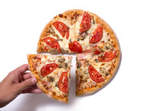 Male hand picking tasty pizza slice Stock Photo