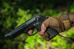 Male hand with pistol Stock Image