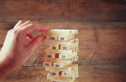 Male hand placing wooden block on a tower. planing and strategy concept Stock Image