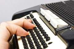 Male hand playing accordion Royalty Free Stock Image
