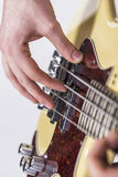 Male hand playing bass guitar Royalty Free Stock Photo
