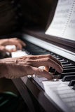 Male hand playing piano. Male hand playing the keys of piano Royalty Free Stock Photo