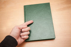 Male hand with pointing finger shows on book Stock Photos