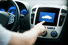 Male hand pointing finger to car icon on panel Royalty Free Stock Photos