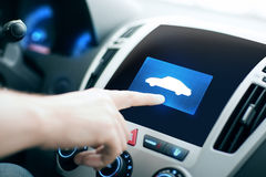 Male hand pointing finger to car icon on panel Royalty Free Stock Images