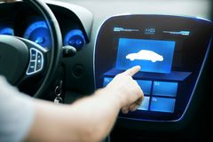 Male hand pointing finger to car icon on panel Royalty Free Stock Photography