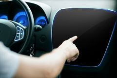 Male hand pointing finger to monitor on car panel Stock Photos