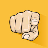 Male hand pointing finger at you over yellow background. Male hand pointing finger at you over a yellow background Stock Photos