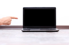 Male hand pointing on the laptop screen Royalty Free Stock Photo