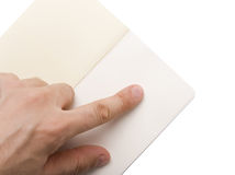 Male Hand Pointing on Notepad Stock Photography