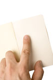 Male Hand Pointing on Notepad Royalty Free Stock Photography