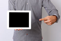 Male hand pointing on the tablet computer screen Royalty Free Stock Image