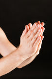 Male hand praying Stock Photo