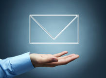 Male hand presenting virtual mail icon Stock Photos