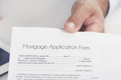 Male hand presents a mortgage document. Stock Image