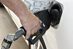 Male hand pumping gas. Close up of man's hand  pumping gas at service station Royalty Free Stock Photo