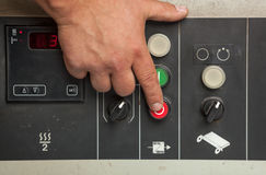 Male hand pushing red stop button. Royalty Free Stock Photos