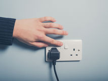 Male hand pushing switch Stock Image