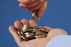 Male hand puts coins in the palm his partner Royalty Free Stock Photos