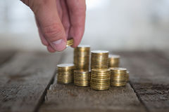 Male hand putting money coin Stock Photography