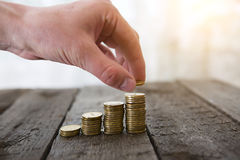 Male hand putting money coin Royalty Free Stock Photo