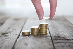 Male hand putting money coin Stock Photo