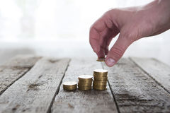 Male hand putting money coin Royalty Free Stock Image