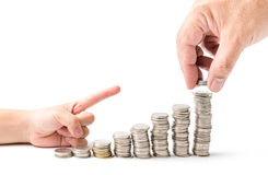 Male hand putting money coin stack growing business Royalty Free Stock Photos