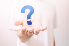 Male hand with question mark. Selective focus Royalty Free Stock Image
