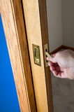 Male hand reaching for a concealed pocket door Stock Image