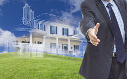 Male Hand Reaching for Handshake with Ghosted House Drawing Behi Stock Photography