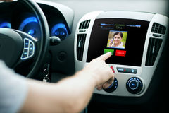 Male hand receiving video call on car panel screen Stock Photography