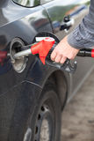 Male hand refilling the car with fuel Stock Photography