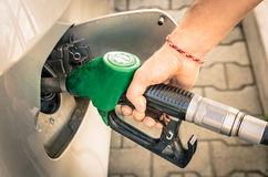 Male Hand refilling Gas at Fuel Station Stock Photos