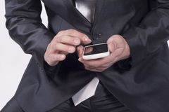 Male hand reviewing information on smart phone Royalty Free Stock Images