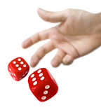 Male hand rolling red dice. Isolated on white background Royalty Free Stock Photography