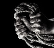 Male hand with rope. Conception aggression Royalty Free Stock Photos