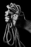 Male hand with rope. Conception aggression Stock Photo