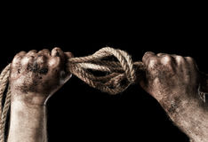 Male hand with rope. Conception aggression Stock Images